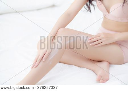 Beautiful Young Asian Woman Touch Skin Leg Smooth With Cream And Lotion For Hydration And Smooth, Gi