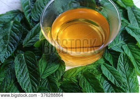 The Picture Shows Peppermint Tea And Peppermint Leaves