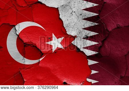 Flags Of Turkey And Qatar Painted On Cracked Wall