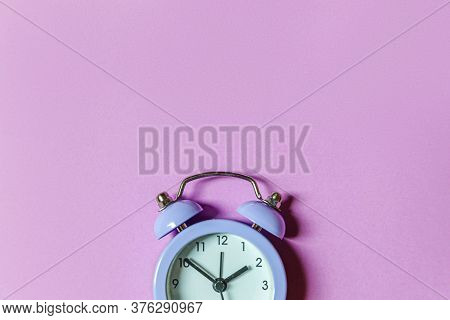 Simply Minimal Design Ringing Twin Bell Vintage Classic Alarm Clock Isolated On Purple Violet Backgr