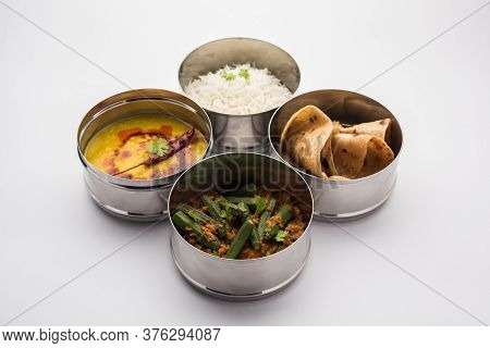 Indian Lunch Box Or Tiffin - Spicy Ladies Finger, Dal Fry, Rice And Chapati