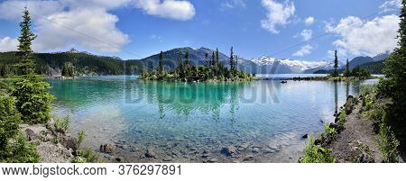Panoramic View Of Glacial Mountain Garibaldi Lake With Turquoise Water On Sunny Summer Day.islands W