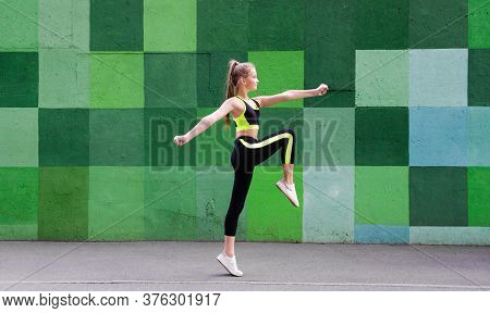 Fitness Sport Young Girl In Sportswear Doing Yoga Fitness Exercise On A Wall Background. Sporty Gymn