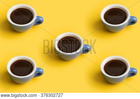 Minimal Pattern With Blue Cup Of Black Coffee At Yellow Background. Concept Of Fragrant Beverage At