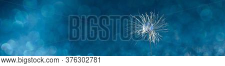 Beautiful Dew Drops On Dandelion Seed Macro. Beautiful Soft Abstract Blue Background. Water Drops On