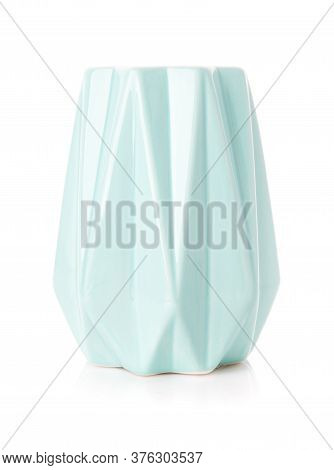 Decorative Ribbed Vase Of Turquoise Color On A White Background.