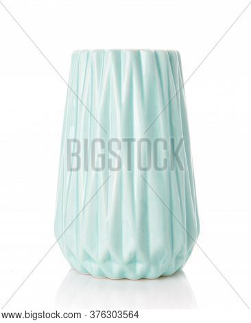 Big Ribbed Vase Of Turquoise Color On A White Background. Home Decor.