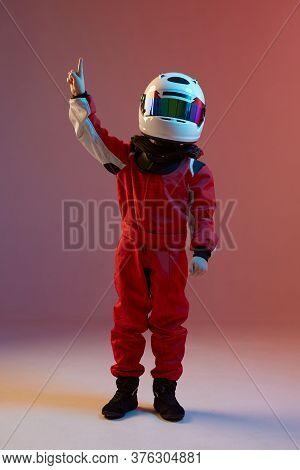 Boy Child Racer In Helmet With Raised Hand, Standing In Neon Light. Kart Racing School Poster