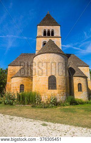 Saint-Leon-sur-Vezere; France - August 17; 2019: The Romanesque church (XIIth century), classified as a historical monument in Saint-Leon-sur-Vezere, Dordogne, France