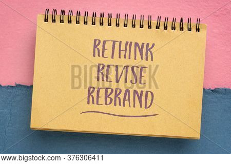 rethink, revise, rebrand - motivational handwriting in a spiral sketchbook, business or personal development concept
