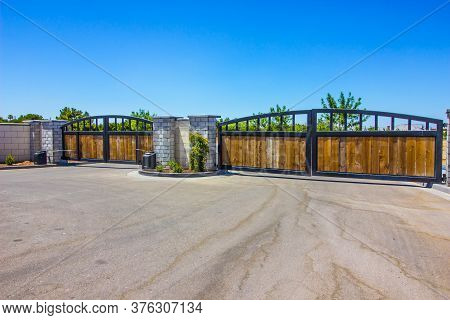 Two Automatic Entrance & Exit Wood & Metal Gates