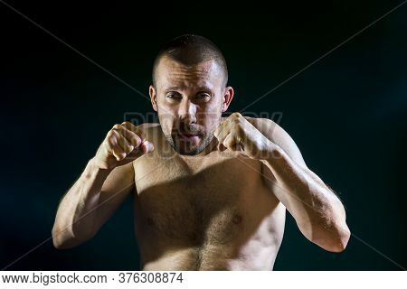A Man In A Fighting Stance With A Naked Torso Box On A Dark Background