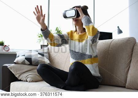 Portrait Of Young Woman Wearing Virtual Reality Glasses And Travel In Different World. Beautiful Fem
