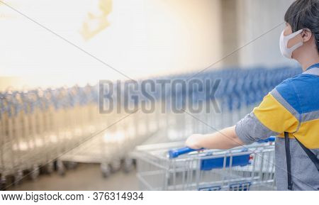 The Asian Girl Pushing The Trolley Cart Shopping The Decorate Funiture For Interior Inside The House