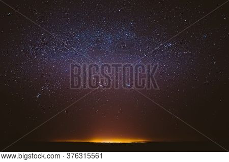Real Night Sky Stars Background With Natural Colourful Sky Gradient. Sunset, Sunrise Light And Starr