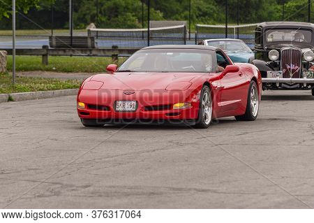Fairhaven, Massachusetts, Usa - July 4, 2020: Red Corvette Passing Fort Phoenix During Fairhaven Fou