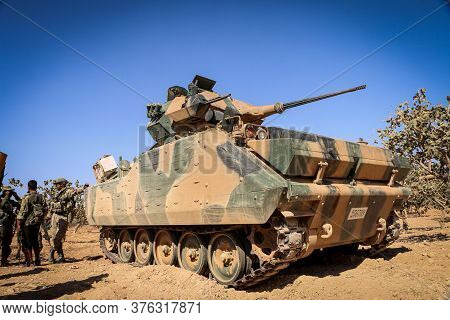 Turkish Soldiers Accompanied By Fsa Soldiers. A Soldier Drives The Tank And Another Soldier Tracks T