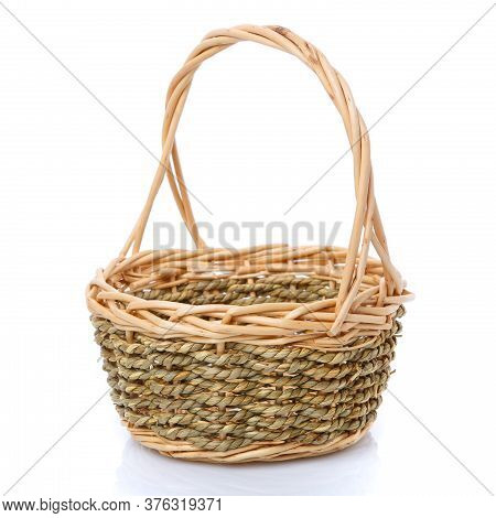 Basket Woven From Natural Vine Isolated On A White Background.