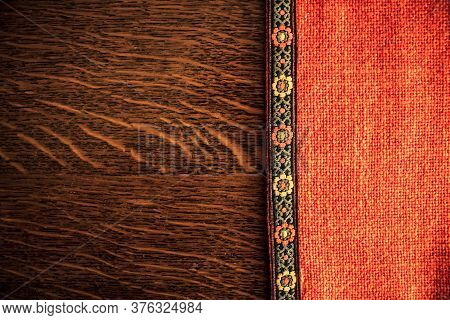 Shot To A Rustic Backround Made From An Orange Rustic Cloth And A Dark Brown Wooden Plank In Transil