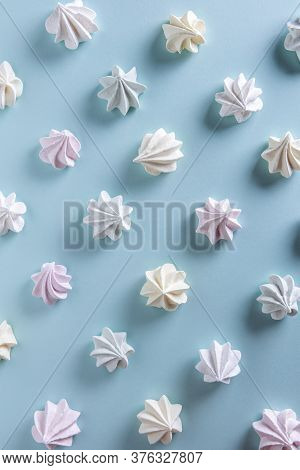 Pattern With Delicate Light Green, White, Yellow And Pink Meringue Cookies. Meringues Are Lying In R