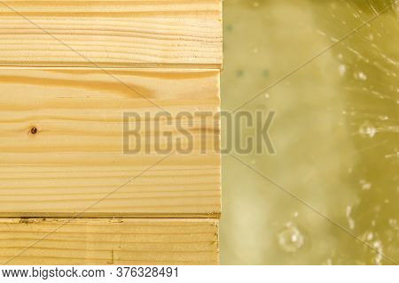 Close Up Shot To A Few Wooden Planks And A Few Water Splashes