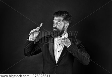 Retro Appeal. Bearded Man Hold Retro Razor. Professional Barber Dark Background. Retro Barbershop. B