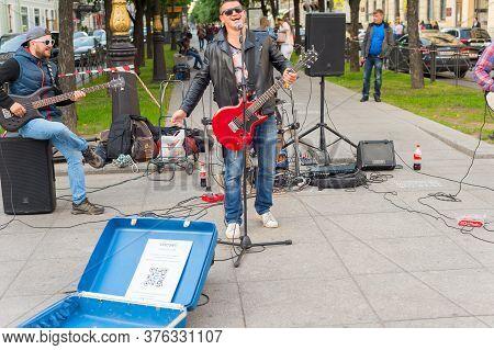 Saint Petersburg, Russia - July 11, 2019: Musicians Perform On A Street Of St. Petersburg. Putin Por