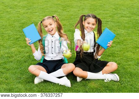 Nutrition Education For Kids. Happy Kids Hold Apples And Books Outdoors. Small Kids Enjoy School Bre