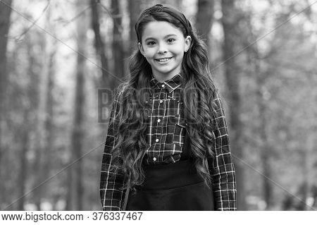 Biggest Hair Accessory Trends. Adorable Little Girl Checkered Shirt Wear Red Headband. Fashion Trend