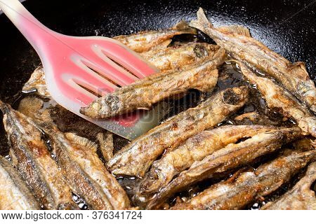 Capelin Fish Is Fried In A Pan In Vegetable Oil. Cooking, Seafood.