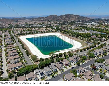 Aerial View Of Water Recycling Reservoir Surrounded By Suburban Neighborhood In San Diego County, Ca