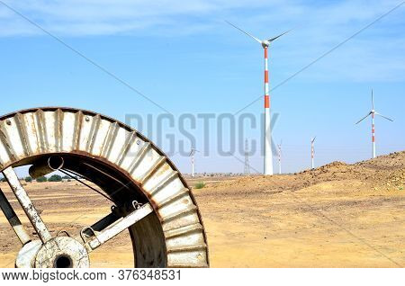 Windmills In The Backdrop Of A Winding Wheel On The Way To Sam Sand Dunes (thar Desert) From Jaisalm