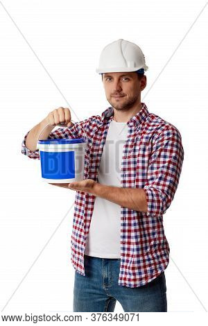 Caucasian Handyman Worker In Plaid Shirt And Hard Hat Holding Can With Paint. Builder Or Painter Dec
