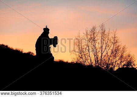 Sights Of Prague, Czech Republic. Beautiful Landscape Silhouettes Of Sculptures Against Sky. Sunset