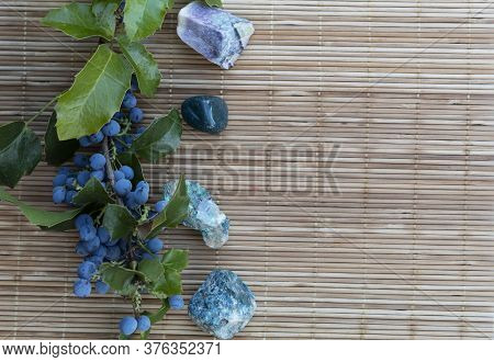 On A Wooden Background On The Side Are Semiprecious Stones - Heliotrope, Malachite, Fluorite, Apatit