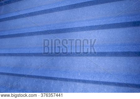 Metal Construction, Blue Profiled Material  For Coating Roof House Or Fence. Construction Industry.