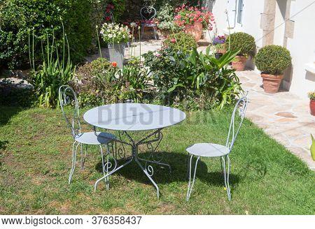 Garden Furniture In Wrought Iron On Grass