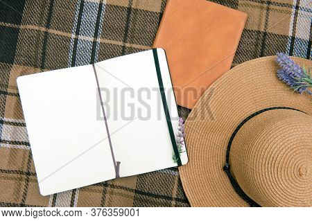 Summer rest mock up with hat and diary on a plaid mat, outdoor flat lay photo, girlish secrets concept
