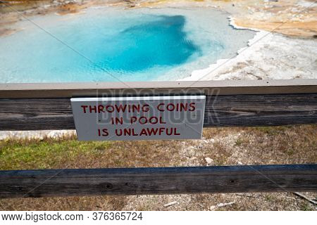 Sign - Throwing Coins In Pool Is Unlawful At The Fountain Paint Pots Area Of Yellowstone National Pa