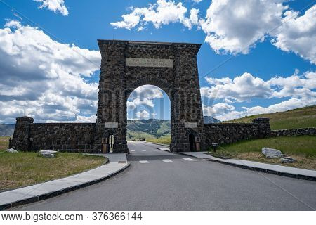 Gardiner, Montana - July 1, 2020: The Famous Roosevelt Arch At The North Entrance Of Yellowstone Nat