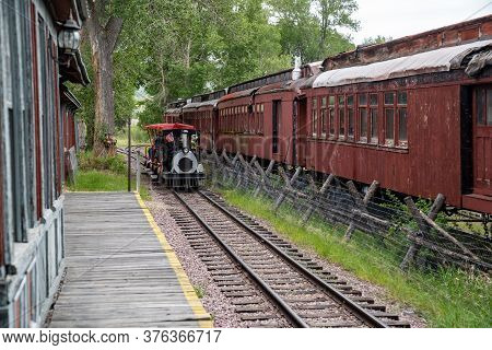 Nevada City, Montana - June 29, 2020: Tourists Ride A Train To See The Two Sister Ghost Towns Of Vir