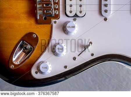 Closeup From An Electric Guitar, Volume And Tone Switch And Some Strings
