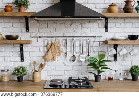 Element Of Kitchen Appliance In Apartment With Modern Interior, Gas Stove, Cooking Hood, Kitchenware