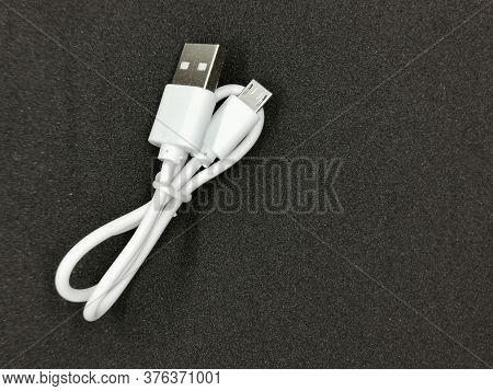 Charging Cable Type C For A Fast Phone Charge With On A Black Propylene Background