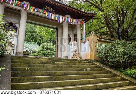 Nantou, Taiwan - June 25th, 2019: gate of wooden door at Xian Fo temple, Nantou, Taiwan