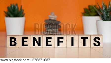 Benefits Word Written On Wood Block. Benefits Text On Wooden Table For Your Desing, Concept.