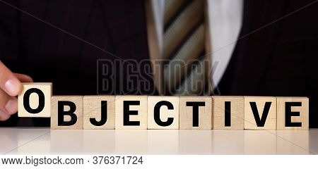 Objective Word Made With Wood Building Blocks
