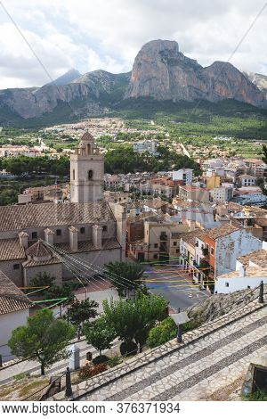 Village Of Polop De Marina With Church And Rocky Mountainrange, Costa Blanca, Spain