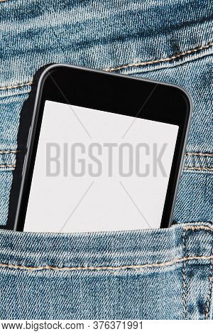 Mobile Phone With Blank Mockup Screen In The Pocket Of Blue Jeans