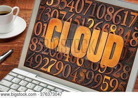 cloud computing concept - word in vintage letterpress wood type against number background on a laptop screen